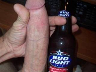 Here's a bottle for a comparison reference.  Well, ladies, which would you prefer to suck from?   >;-)~