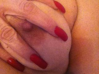 Close up of my sexy wife's huge titties and hard nipple.